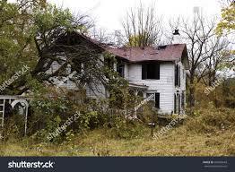 abandoned burned historic house overgrown garden overgrown stock