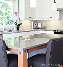 quartz island with gray soapstone formica countertops maple