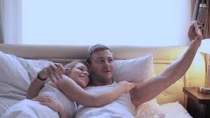 Girls In Bed by Man And Woman In Bed Doing Selfie With A Guy Taking Pictures