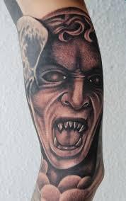 art junkies tattoo studio tattoos religious demon black and