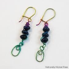 niobium earrings lapis lazuli trio with oval dangles with rainbow niobium wirework