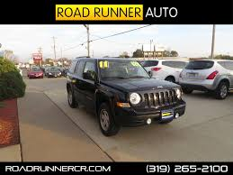 beige jeep liberty road runner auto sales and service cedar rapids iowa