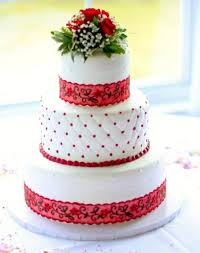 3 tier wedding cake with red floral decor jpg