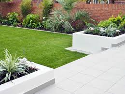 sawn sandstone paving easy grass raised beds hardwood screen and