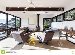funky retro beach house living room with 70s style chairs stock