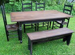 black rustic dining table distressed black and walnut country dining table wes dalgo