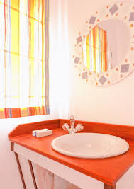 picturesque coastal cottage bathroom vanities with colorful blinds
