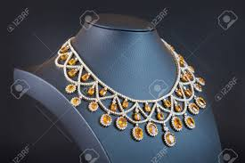 yellow sapphire necklace images Diamonds with yellow sapphire necklace on the black background jpg