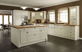 Island In A Small Kitchen by Kitchen Designs White Cabinets With Dark Granite Backsplash