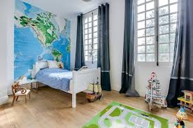 bright childrens room with white bed and big windows with gray
