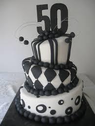 black and white topsy turvy 50th birthday cake c u0027est la vie