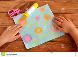 kids crafts applique with paper flowers child put his hands on
