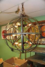 industrial sphere chandelier metal strap globe hanging light with