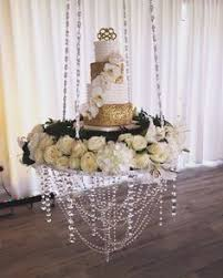 wedding cake table cake swing is available to hire through chandeliers to die