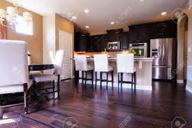 dark cabinets and wood flooring sharp home design