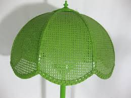 1960s lime green enameled metal table lamp with wicker shade at