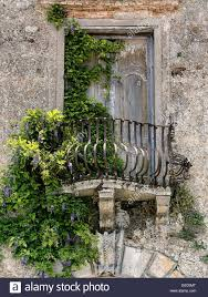 historic house with balcony and plants in italy stock photo