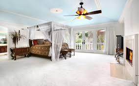 room bedroom bed canopy bedside table plant chandelier tv