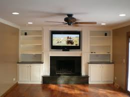 tv above electric fireplace with bookshelves rick electrical