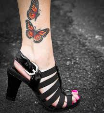 lovely monarch butterflies tattoo on ankle tattoos