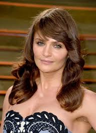long hairstyles with bangs for women over 40 helena christensen layered long brown wavy hairstyle with bangs