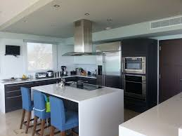 contemporary kitchen with corian counters by esteban sarmiento