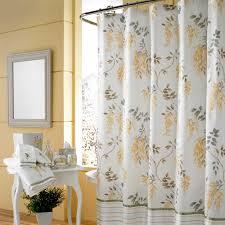 dark shower curtain with polka dots motive in small bathroom