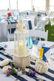 nautical wedding party nautical centerpieces with lighthouses and monkey u0027s fist