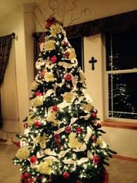 tree using clear lights with ribbon bow as topper
