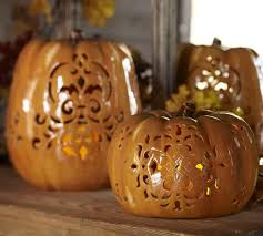 ceramic pumpkins punched ceramic pumpkin luminaries pottery barn