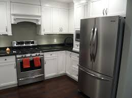 pictures of white kitchen cabinets with black stainless appliances kitchens scotwend homes ltd black stainless appliances