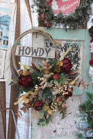 christmas howdy western wreath with burgundy and gold flowers