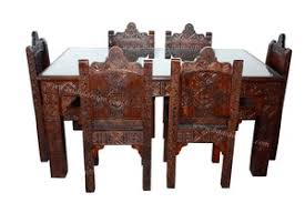 Carved Dining Table And Chairs Moroccan Carved Wood Dining Room Table With 6 Chairs From Badia