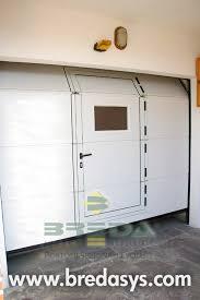 go porte sezionali stop go porte sezionali breda con porta pedonale inserita