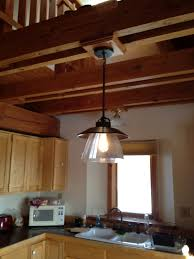 exterior faux ceiling beams with antique pendant lighting by