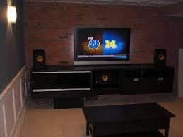 floating black entertainment center ikea and exposed brick wall