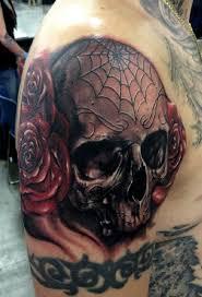 skull with spider web tattooed tattoos