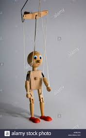 string puppet a marionette puppet on strings without any clothes stock photo