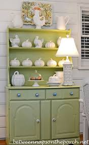 painting stained furniture a china hutch makeover