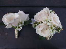 corsage and boutonniere set matching boutonniere and corsage with white spray roses corsages