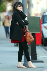 zooey deschanel in a black coat and leggings wwzdw what would