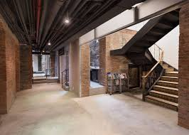oma renovates studio for artist cai guo qiang in new york