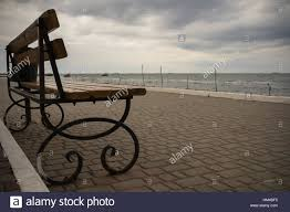 Wrought Iron Bench Seat Empty Wrought Iron Bench With Wooden Seat And Back On A Deserted