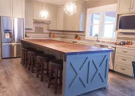 wooden kitchen island farmhouse chic sleek walnut butcher block countertop barn wood
