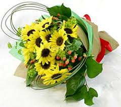 bouquet of sunflowers so sunflower wrapped posh posy florist tybee