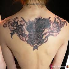 collection of 25 back shoulder dragon tattoo for women