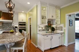 photos cabinet studio hgtv traditional kitchen with marble countertops and wrought iron pendant lighting