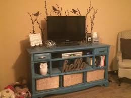 repurposed old dresser into a entertainment center pallet tv