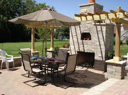 exterior patio sails sun shades with light over black iron dining