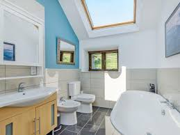 bathroom far house the main bathroom in the house has an extremely light and airy feel to it with two large skylights a luxurious roll top bath a toilet and bidet
